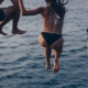 people jumping in the water - try new things