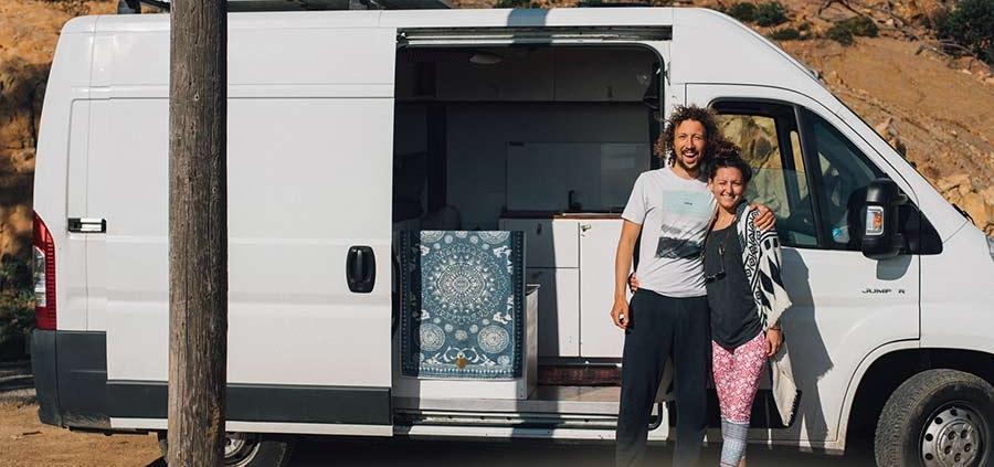 couple in front of van - salty roamers