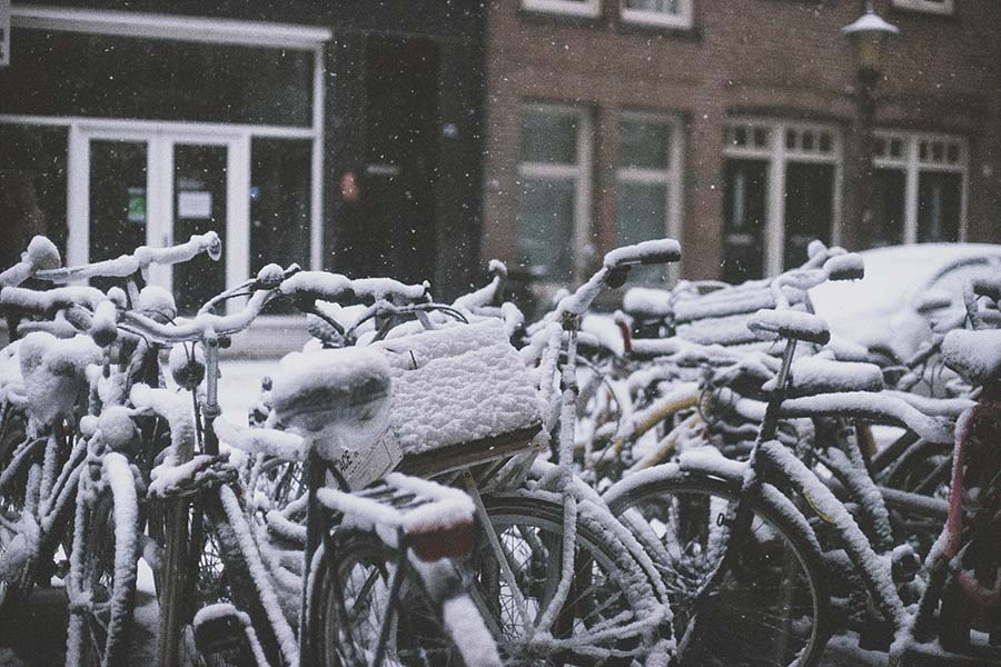 snowy bikes - winter in Amsterdam