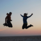 2 people jumping in the air - Eva and Brian