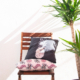 two throw pillows, a chair and a plant - designsoup by alix